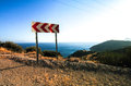 Road sign turn left on coast of turkey around coastal line Stock Images