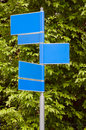 Road signs with a green leaves background blank in blue color Royalty Free Stock Photo