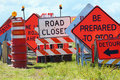 Road signs stacked by road montage