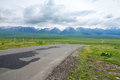 Road with snow mountains asphalt located in xinjiang china Stock Photo