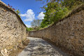 Road between stone walls narrow in a small french town Royalty Free Stock Images