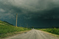A road and storm sky with heavy clouds ready to start Royalty Free Stock Photos
