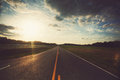 Road at sunset empty country Royalty Free Stock Photo