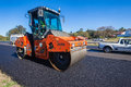 Road surfacing asphalt machine roller construction team laying new tar surface to local highway outside durban south africa close Stock Photos