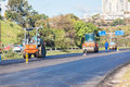 Road surfacing asphalt machine rollers construction team laying new tar surface to local highway outside durban south africa photo Royalty Free Stock Photos