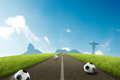 Road to brazil soccer ball onroad with brazilian skyline background Stock Photography