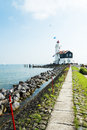 The road to lighthouse marken netherlands Stock Image