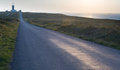 The road to lighthouse at sunset france image of perspective with on cape raz plogof bretagne Stock Photo