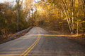 Road to no where country leading in late afternoon fall sunlight Royalty Free Stock Images