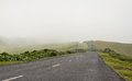 Road to nowhere in azores portugal landscape with winding Royalty Free Stock Images