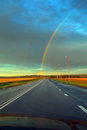 Road to rainbow landscape with between the fields Royalty Free Stock Photography