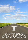 Road to success word and arrow on countryside receding into distance Royalty Free Stock Images