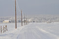 The road to village beautiful winter landscape with a long frozen that leads Stock Photography