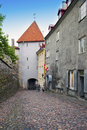 Road through a tower in old Tallinn Royalty Free Stock Photo