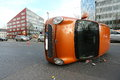 Road traffic accident duesseldorf germany a small car lies on its side after cutting across infront of a truck and colliding the Royalty Free Stock Photo