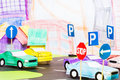 Road traffic in the toy town with handmade cars Royalty Free Stock Photo