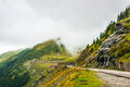 Road transfegerash serpentine in the mountains of romania pass the in the fog Royalty Free Stock Image