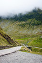 Road transfegerash serpentine in the mountains of romania pass the in the fog Royalty Free Stock Photo