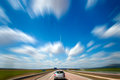 Road trip blue sky and car motion blur and speed Stock Image