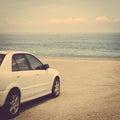 Road trip car sea ocean sand beach Royalty Free Stock Photo