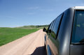 Road trip suv driving on gravel and sand in south dakota usa Stock Image
