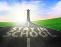 Road with up arrow sign and stay in school text written on the Royalty Free Stock Images