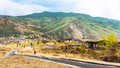 Road and village with high mountain and huge cloud above Thimphu Royalty Free Stock Photo