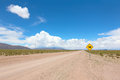 Road with warning sign Royalty Free Stock Photo