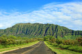 Road in west oahu hawaii landscape with mountains Royalty Free Stock Photo