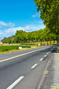 Road winding paved near vineyard in france Royalty Free Stock Photography