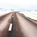 Road in winter mountain landscape Royalty Free Stock Photo