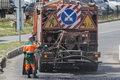 Road worker carries out repairs to the road