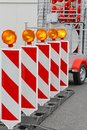 Road works barrier with amber beacon flashing lights Royalty Free Stock Image