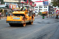 Road works india indian people working at construction at kerala they are using modern machinery now Stock Photos