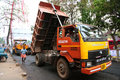 Road works india indian people working at construction at kerala they are using modern machinery now Stock Images