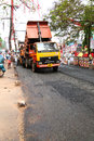 Road works india indian people working at construction at kerala they are using modern machinery now Royalty Free Stock Photography