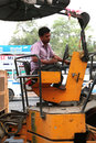 Road works india indian people working at construction at kerala they are using modern machinery now Stock Photography