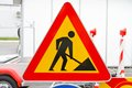 Road works sign triangular traffic at construction site Royalty Free Stock Photography