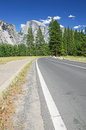 Road through yosemite national park with half dome in the background california usa Royalty Free Stock Photos