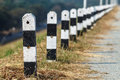 Roadside barriers painted with white and black colors Royalty Free Stock Images