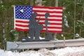 Roadside memorial a patriotic to fallen soldier Stock Photo