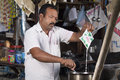 Roadside tea vendor indian making Stock Image