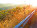 Roadside verge sunshine on and crash barrier Stock Image
