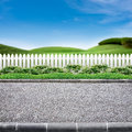 Roadside and white fence Stock Images