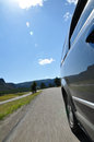 Roadtrip rear view along the side of a riding car feeling Royalty Free Stock Photo