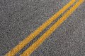 Roadway asphalt concrete pavement surface grey background with yellow line Royalty Free Stock Photo