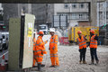 Roadworks near Tower Hill were manual workers are working as a team. They have a break. Royalty Free Stock Photo