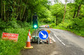 Roadworks Signs and Traffic Light Royalty Free Stock Photo