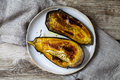 Roast aubergine on the plate Royalty Free Stock Photo