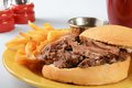 Roast beef au jus a sandwich with french fries Stock Photography